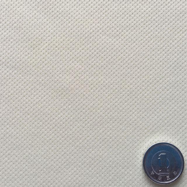 【表面生地拡大】凹凸のエンボス加工がされていて肌触りがサラサラです。写真では色目が分かりにくいですがシーツの色はクリーム色です。